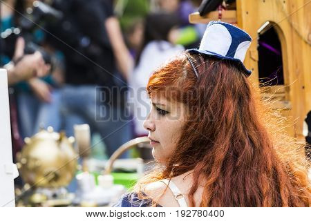 CAGLIARI, ITALY - JUNE 1, 2014: Sunday at the Great Jatte Public Gardens - portrait of a beautiful woman wearing a Victorian costume - Sardinia