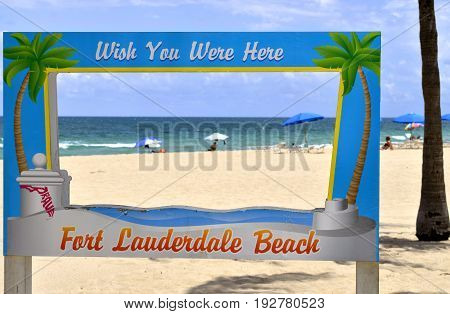 Fort Lauderdale Beach Florida USA - May 16 2017 : Wish you were here sign on Fort Lauderdale Beach