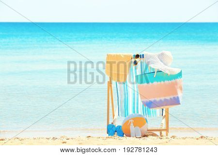 Beach chair and accessories at sea shore. Vacation concept