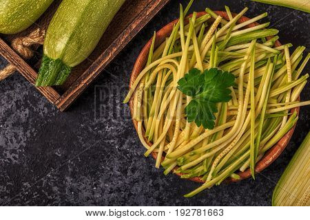 Raw Zucchini Pasta On Dark Background.