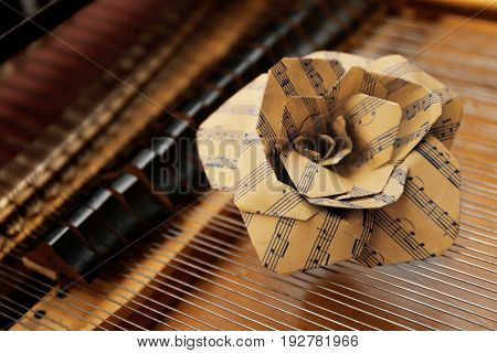 Rose made of music notes inside piano