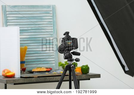 Professional camera on tripod while shooting food
