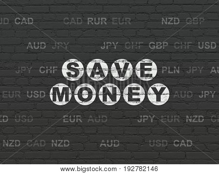 Money concept: Painted white text Save Money on Black Brick wall background with Currency