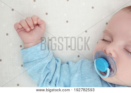 Cute little baby sleeping on bed at home, closeup