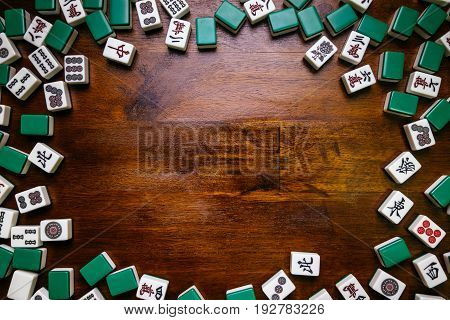 Mahjong tiles on wood table background