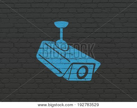 Security concept: Painted blue Cctv Camera icon on Black Brick wall background