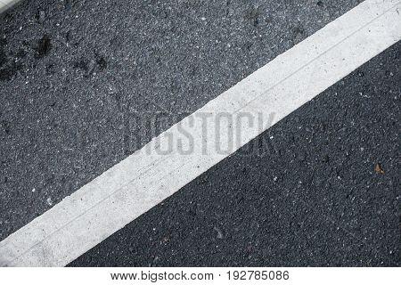 dark gray tarmac texture with white line