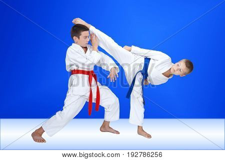 Circular kick and block two athletes are training