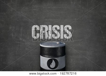 Closeup of metallic oil barrel under crisis text on blackboard