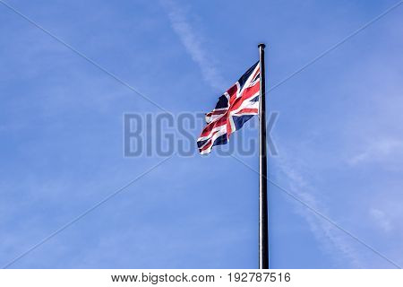 The British flag waving in the wind .