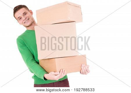 Young delivery man behind the boxes. so funny. isolated white background. Sitting on the floor