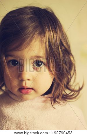 Portrait of Cute sad baby girl  thinking indoor