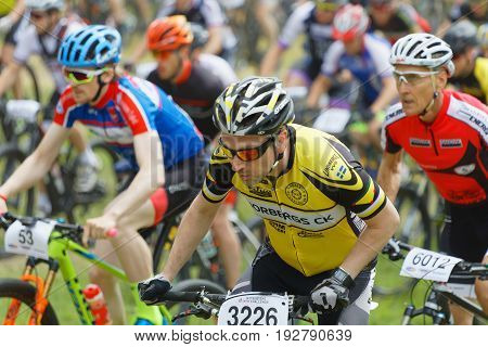 STOCKHOLM SWEDEN - JUNE 11 2017: Closeup of colorful male mountain bike cyclists at Lida Loop Mountain bike Race audience in background. June 11 2017 in Stockholm Sweden