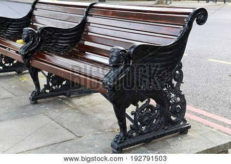 LONDON, GREAT BRITAIN - MAY 15, 2014: This is a cast-iron sphinx as a decorative design of street benches on the Victoria Embankment.