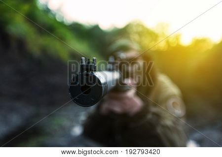 Focus woman aiming soldier muzzle background horizontal