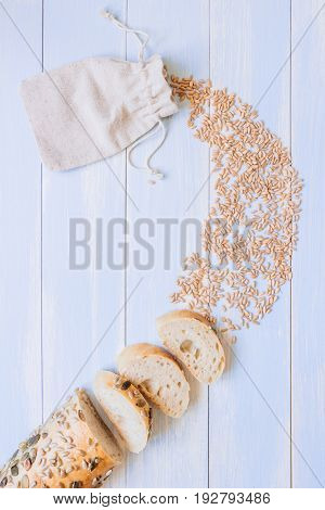 Fresh Sliced Mixed Seed Baguette And Wheat Grains On The Wooden Table, Top View