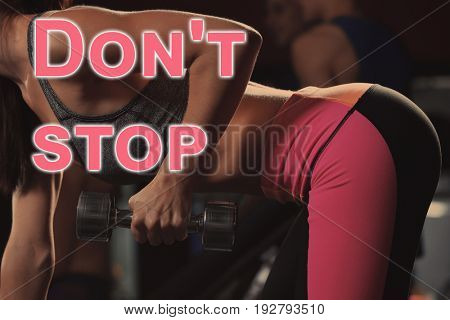 Fitness quotes. Text DON'T STOP and young woman training with dumbbell on background