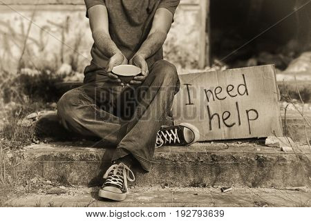 Poverty concept. Poor man begging for money on street