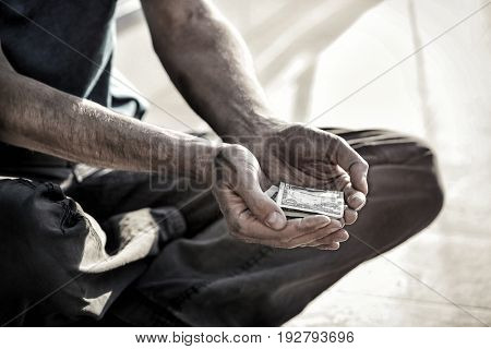 Poverty concept. Poor man begging for money on street, closeup