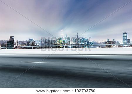 empty road near modern buildings in shanghai