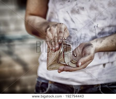 Poverty concept. Poor woman counting money, closeup