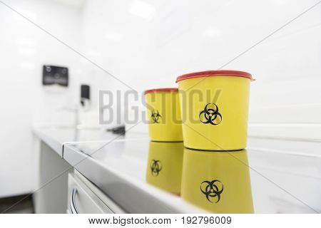 It is dangerous. Close up bright cases situating on table in sterile apartment