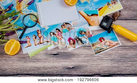 Beautiful color photographs of slender girls in bathing suits resting on the sea on a table with a map and a magnifying glass and video camera gopro.