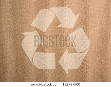 Concept of environmental conservation and protection. Symbol of recycling on cardboard background
