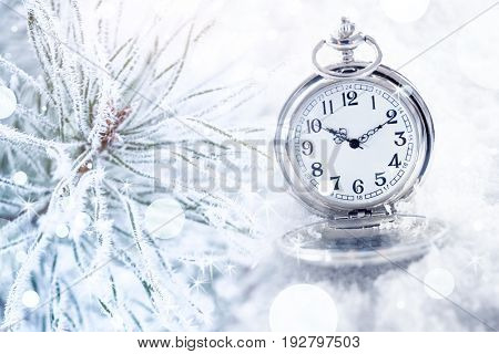 Countdown to Christmas celebration. Pocket clock and coniferous branch, closeup