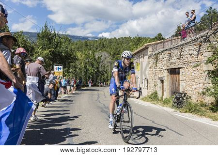Mont Ventoux France - July 142016: The Belgian cyclist Julien Vermote of Team Etixx-Quick-Step riding on the road to Mont Ventoux during the stage 12 of Tour de France 2016.