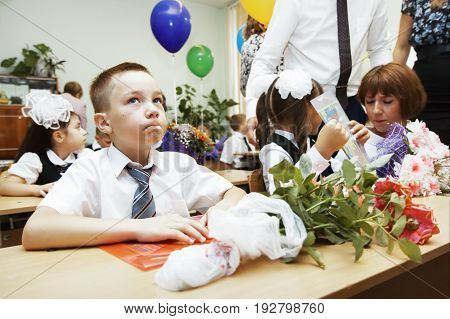 Russia Moscow-September 01 2016: First-graders prepare for their first lesson at school