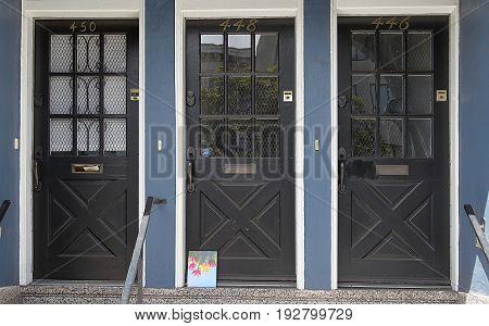 San Francisco, California - April 13, 2017. Three wood & glass doors in North Beach district of San Francisco, California