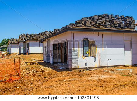 Three New Construction Homes With Roofing Materials
