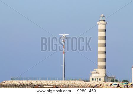 Jesolo, Italy - June 02, 2017 : lighthouse for access to the tourist and commercial port