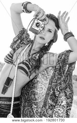 Trendy Hippie Outdoors In Summer Evening With Retro Photo Camera
