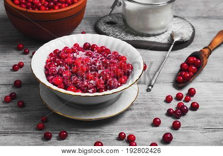 Cranberries (lingonberry, Cowberries) On Light Wooden Background.