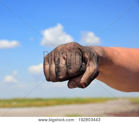 The man's hand is fisted close up