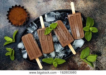 Vegan banana chocolate mint fudge popsicles. Homemade creamy dairy free ice pops nice cream fudgesicles