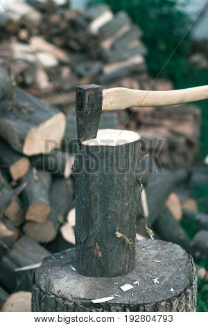 Felling firewood with an ax with a blurred background
