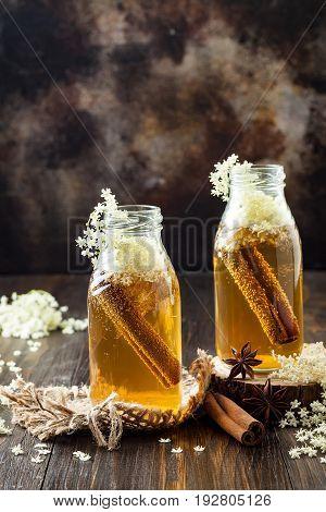 Homemade fermented cinnamon and ginger kombucha tea infused with elderflower. Healthy natural probiotic flavored drink. Copy space