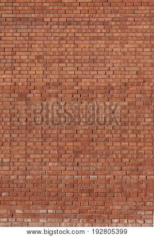 Red brick wall background texture. Vertical view