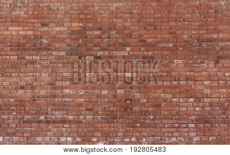 Red brick wall background texture. Horizontal view