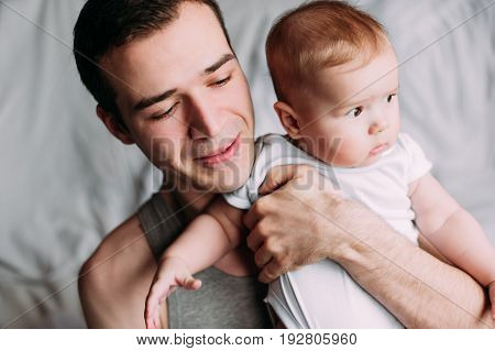 Portrait Of Loving Father With Baby Boy 4-6 Months His Son At Ho