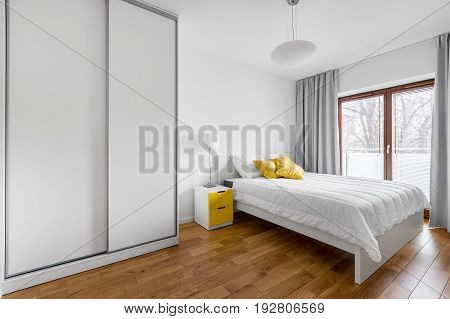 Bedroom With White Wardrobe