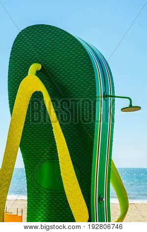 Beach Shower In The Shape Of A Flap On The Beach Promenade In The Seaside Town, A Large Green Flip F