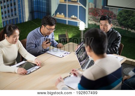 jinhua,china-Jan 23,2017:sales team discussing in meeting room