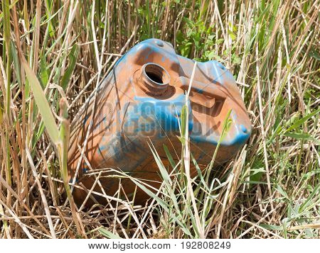 Empty Old And Blue Oil Tank In Grass