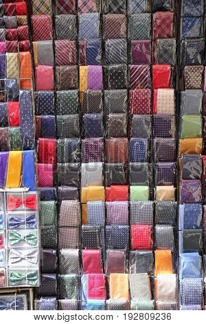 Collection of colorful cravats on a market stall in Florence in Italy.