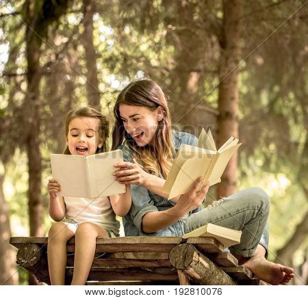 Mom And Daughter Read The Book