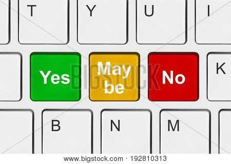 Computer keyboard with Yes No and Maybe keys - business concept